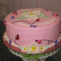 "Ladybug Shower Cake This fondant cake is a 10"" white cake with lemon filling for a baby shower. Cake made to match nursery. The ladybugs, butterflies and..."
