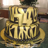 "Gold With Black Zebra Stripe  This is a 10"" and 8"" fondant covered red velvet cake. It was first airbrushed gold and then added fondant zebra stripes. 74 is..."