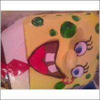 Spongbob Cake   Chocolate cake with cookie buttercreme. Spongebob made with all fondant and colored in circles.( cheese holes)