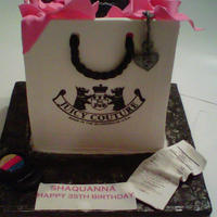 Juicy Couture Hand Bag Cake Made by PPCAKESTUDIO.COM This hand bag made out of fondant and modeling chocolate> Tissue paper is gum paste> Hand made Mac...