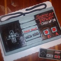 Retro Nintendo Controller Graduation Cake 1/4 sheet cake trimmed a little to be more rectangular. Going from a controller the client gave me. iced in buttercream with MMF accents....