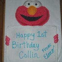 Elmo With Sign For my nephews birthday. A sheet cake with the message and elmo shaped cake for head...hands are piped on to look like he's holding...