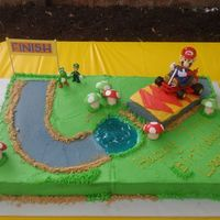 Mario Kart Birthday Cake Full sheet cake, half choc, half yellow...buttercream icing, the mushrooms are handmade MMF...for my son's 7th birthday. The big Mario...