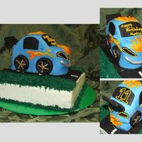 "Hot Wheels Birthday Cake Car is wasc with strawberry cream filling covered in MFF. Royal icing used for flame details. ""Road"" base was carrot cake with..."