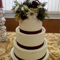 50Th Wedding Anniversary Cake   6, 8, 10 in vanilla cake, all done in BC with ribbon around the bottom of each tier. TFL