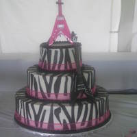 Rockstar Wedding Cake   6, 10, 14in done in bc with fondant zebra strips and hot pink ribbon around the bottom of the tiers. tfl!