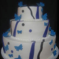 Butterfly Wedding Cake   6,10,14 inch done in bc with fondant butterflies and strips.