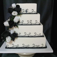 Black And White Wedding Cake This is all done in bc with fake silk flowers that the bride wanted on the cake.