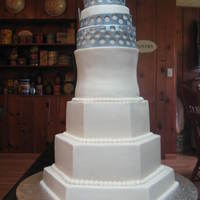 Wedding Cake   4,5,6,8,9,12,15in cakes, done in bc with gumpaste cake topper sprayed with edible glitter. TFL