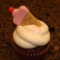 Ice Cream Cone Cupcake   All buttercream with fondant ice cream cone.