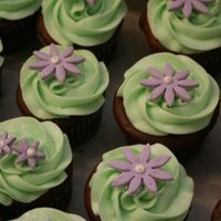 Flower Cupcakes   buttercream icing...candy clay flowers