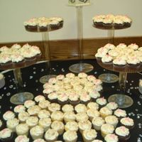 "Cupcake Wedding   ""Aloha"" cupcakes, and choc. cupcakes topped with monogramwedding was black , white and pink(not a great pic)"