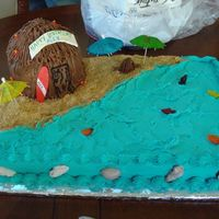 Hawaiian Theme Cake   half sheet cake and half ball panshells are candy melts---wooden surfboard