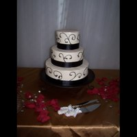 Black Scrolls Wedding Cake Simple and elegant wedding cake. Tiers are 6, 9 12 inch rounds with buttercream and black scrolls.