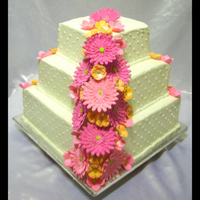 Pink Daisy Wedding Cake This was so fun to do! I made the gumpaste gerbera daisies to match the brides invite. Her colors were pink and orange. All the flowers are...