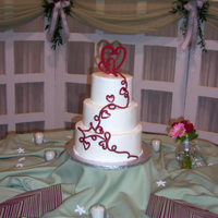 Romantic Wedding Cake This cake was designed to match the wedding invitation. The cake topper and the cascade of hearts and scrolls were made from gumpaste. The...