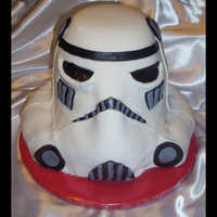 Storm Trooper Had a fun time making this cake. It's a strawberry/tahitian vanilla cake. I used one 6 in, three 8 in, and used carved pieces for the...