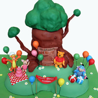 Pooh Bear Cake Cake for my nephew's first birthday! This is Pooh's Tree House with a party going on in front of it. The tree is rice krispies...