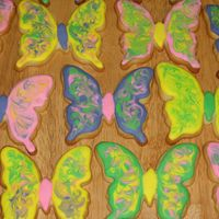 Butterfly Cookies I used different colors of thinned royal icing, and swirled around with a toothpick to make the designs on the wings.