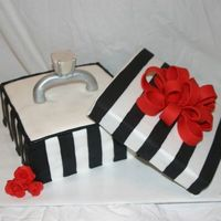 Proposal Ring  Box made to look like a local jewelers box. The guy who ordered the cake used it to propose to his girlfriend! Fondant stripes and bow....