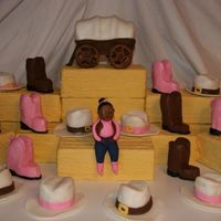Cake That Almost Sent Me To The Funny Farm   Bales of hay are dummy cakes covered in fondant. Hats, boots, and covered wagon are all carved mini cakes. Fondant figure.