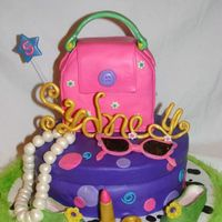 Sydney's Fancy Nancy Cake Hat box and purse are cake. Accessories done in fondant and gumpaste. The party theme was Fancy Nancy.