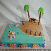 Luau Theme For 40Th Birthday  The lady loved Jimmy Buffet, the Carribean, monkeys, etc. Lei border, covered candles in fondant to look like tiki torches, palm trees were...