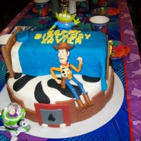 Toy Story WASC 12in bottom cake. Chocolate bed all fondant decorations. Figures are actual toys.