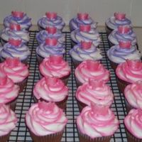 Princess Cupcakes For a 2yr old Birthday. Pink and purple swrirled cupcakes with pink shimmer fondant crowns.