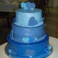 Two Hearts Cascading Blues with fondant heart cutouts.