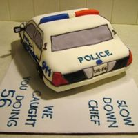 Police Car 3   Another view of my first all-fondant cake. Well, except for the wheels, which are chocolate doughnuts.