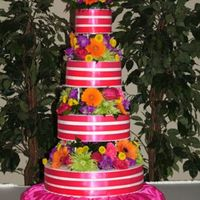 4 Tier Ribbon Cake 16 inch orange cake, 12 inch white cake, 9 inch strawberry cake, 6 inch white cake. Each covered in buttercream icing, with 3 bands of...