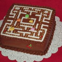 Pacman Cake 8 inch square yellow cake with chocolate buttercream icing.