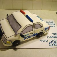 Policecar1 This is my first all-fondant cake. It is made of 3 9x13 layers and then a 9x9 layer on top.
