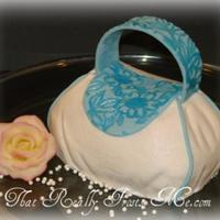"Mini Purse Cake   Purse carved from a 6"" round. The white ""fabric"" is buttercream. The blue accents are fondant."