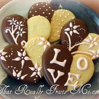 Chocolate Dipped Valentines Sugar cookies half dipped in chocolate. Design piped with royal icing.