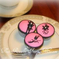 Pink And Black Minis Mini cupcakes decorated with pink and black fondant. TFL