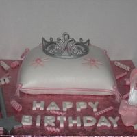 "Pillow Princess Cake Pillow is cake. Tiara, shoe, wand, confetti and tassles are made out of gum paste. ""Happy Birthday"" message is made from fondant..."