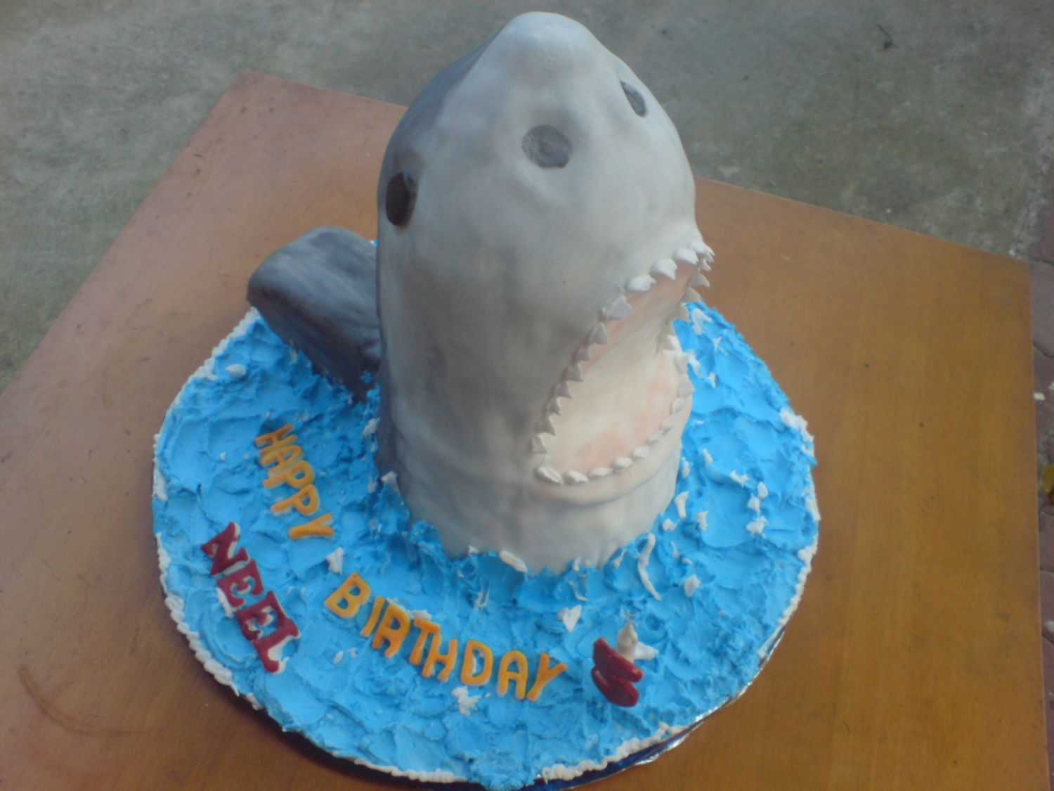 Shark Another cake made in collaboration with my biz partner Shelly2005. She carved the cake and we covered it with MMF. Hand-painted details....