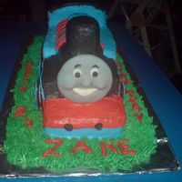 Thomas Carved Thomas Cake with MMF face. Made w/ my biz partner Shelly2005. Took a long time to smooth the frosting.