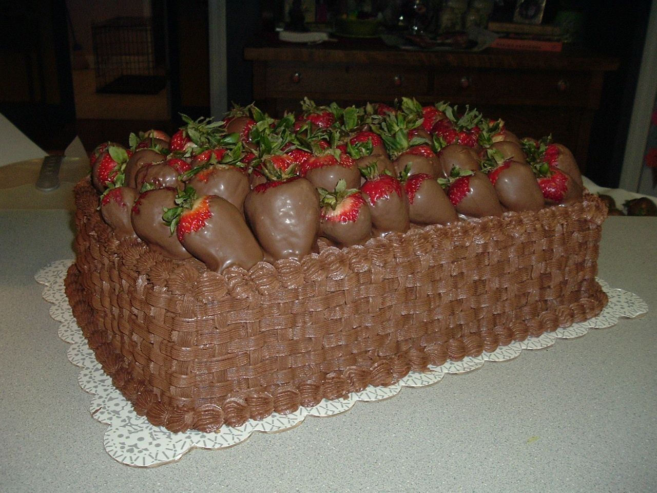 Chocolate Covered Strawberries   Yellow cake with chocolate buttercream frosting and dipped strawberries. I made this for my 3rd graders end of the year picnic
