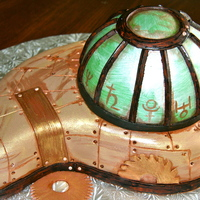 Steampunk Emerald A birthday cake for a friend born in May. She loves steampunk. Covered in a 50/50 fondant/candy clay mix. Chocolate cake with cookies and...