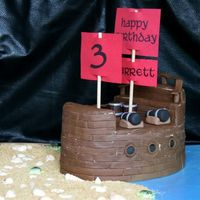 Pirate Ship Port Side Covered in strips of fondant with a roller to make it look like wood. A lot of fun to make!!