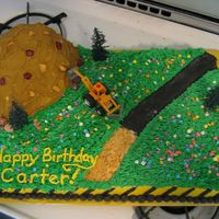 Construction Cake my first paid cake order! yellow 1/2 sheet w Devil's food mountain. BC and fondant/candy accents
