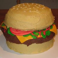 Huge Hamburger This was a cake I made for my husband and his co-workers. The giant hamburger was made up of two 7 inch rounds for the buns and a 8 inch...