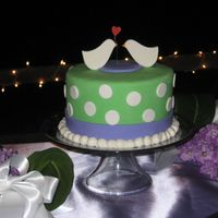 Love Bird Wedding Cake I made this cake for my brother's wedding. They wanted something fun and nontraditional. I made cupcakes with B monograms for the...