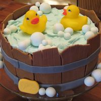 Rubber Ducky In A Tub This cake was so fun to make. It's an 8 in. vanilla cake covered and filled with chocolate buttercream icing. The slats, or boards,...
