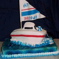 Ken's Sailboat This was my first time to try aribrushing and putting fondant on a 3-D object.
