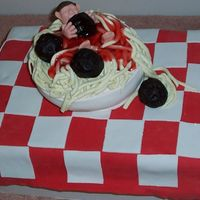 Spaghetti And Meatballs  This cake was done for a guy at work who loves to eat. So I put a figure in the spaghetti as if he was eating his way out. to be fun. I...