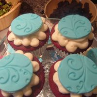 Cupcakes   these were red velvet cupcakes with vanilla bc and fondabt accents